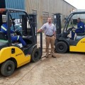 WPPS MD Dewald Walters with operators Richard Kgala and Nako Tolo in the two refurbished forklifts from Smith Power.