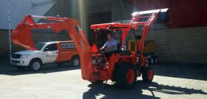 Greg Bergmann operating the Kubota L45