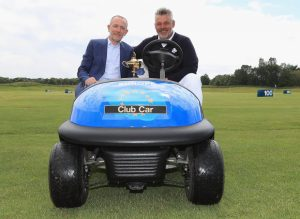 Marco Natale, Vice President of Club Car in EMEA, and Darren Clarke, Captain of The 2016 Ryder Cup European team, in the captain's vehicle that will be supplied to Le Golf National in 2018 (Getty Images)