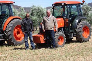 are Left, Kerneels Rabie (Divisional Manager - Lucerne, and (right) Joop Steenkamp (General Manager, De Rustica Estate.)