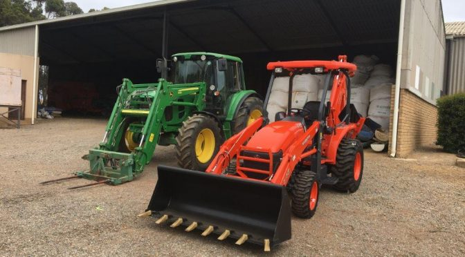 This farmer makes a plan -chooses Kubota because they're the best for these jobs