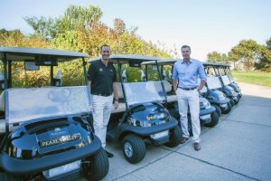 Damian Wrigley and ryk neethling with Club Car