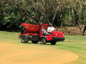 Workman with Top Dresser Pro Pass 200