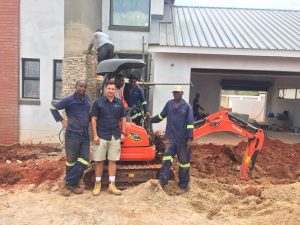 David Buirski (left) with members of the excavation team on site at The Hills Eco Estate, Mooikloof, Pretoria. Image credit: Tarren Bolton