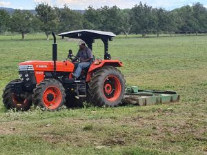 eKubota with Slaher working in the feild